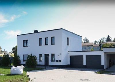Hausbau im Bauhausstil mit Flachdach in Lippstadt
